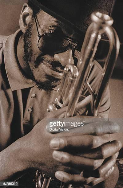 Smiling man holding trumpet