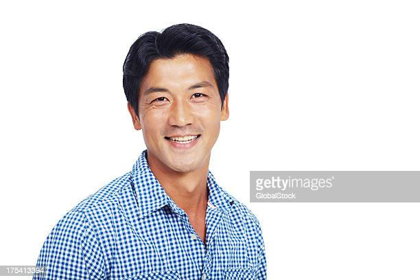 Smiling man in blue and white shirt over a white backdrop