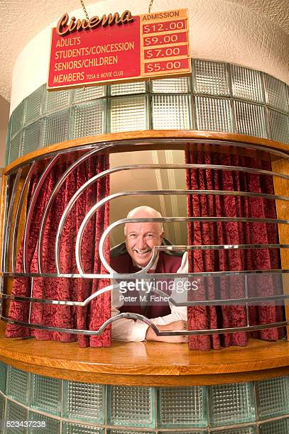 Smiling Man in Cinema Ticket Booth