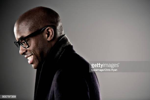 Smiling man in horn rimmed glasses