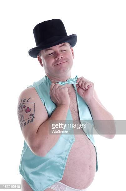 Smiling man in satin vest adjusting bow tie.