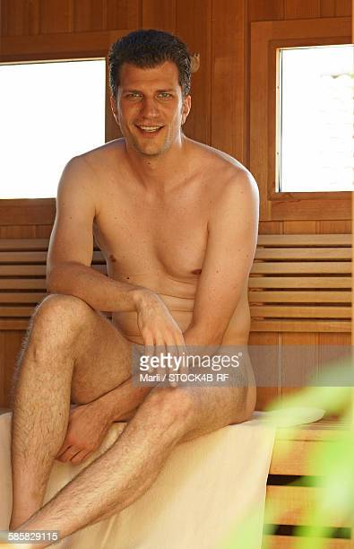 Smiling man in sauna