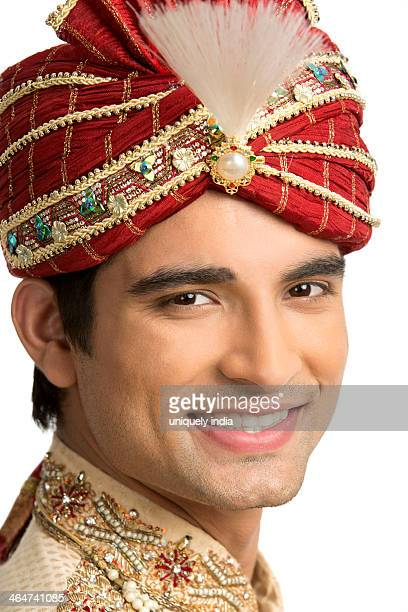 Smiling man in traditional wedding outfit