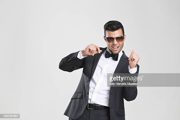 Smiling man in tuxedo dancing