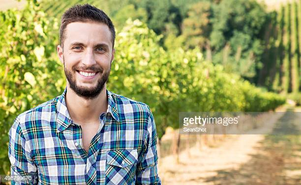 smiling man in vineyard - producer stock pictures, royalty-free photos & images