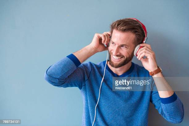 Smiling man listening to music with headphones