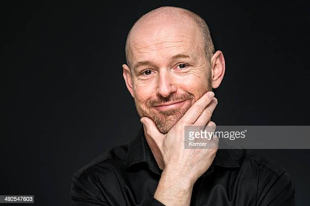 smiling man looking at camera - completely bald stock pictures, royalty-free photos & images