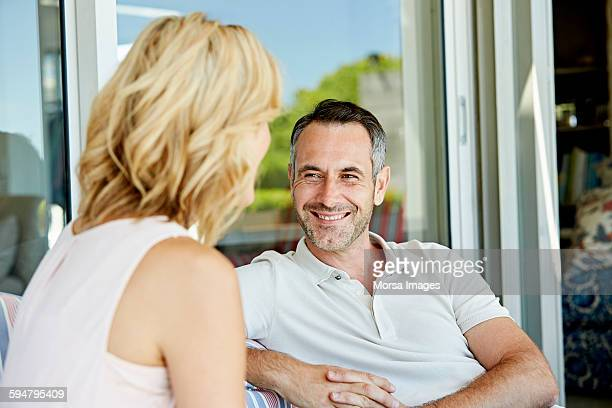 Smiling man looking at woman