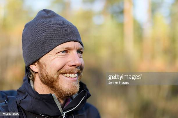 smiling man looking away - dalsland stock photos and pictures