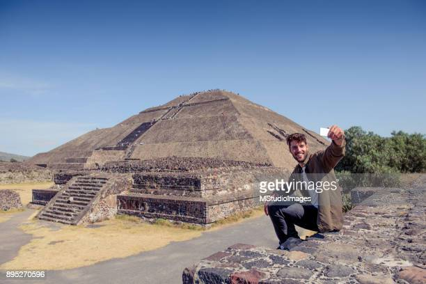 smiling man making self portrait. - mayan people stock photos and pictures