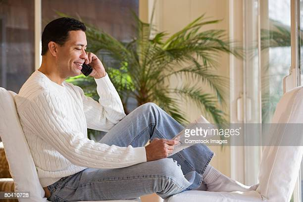 smiling man on cell phone outdoors - 40 49 years stock pictures, royalty-free photos & images