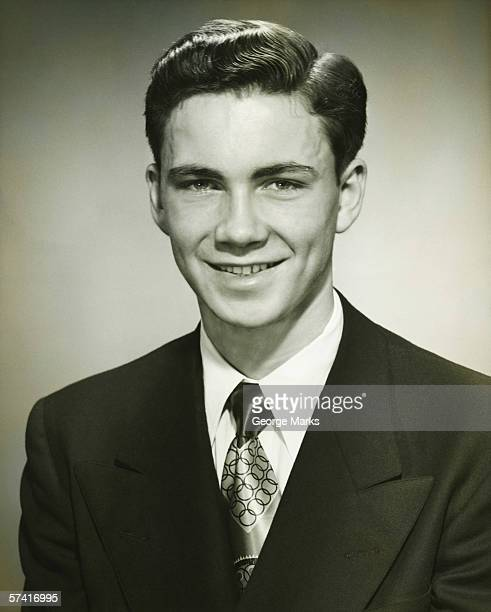 smiling man posing in studio, (b&w), (close-up), (portrait) - 20th century stock photos and pictures