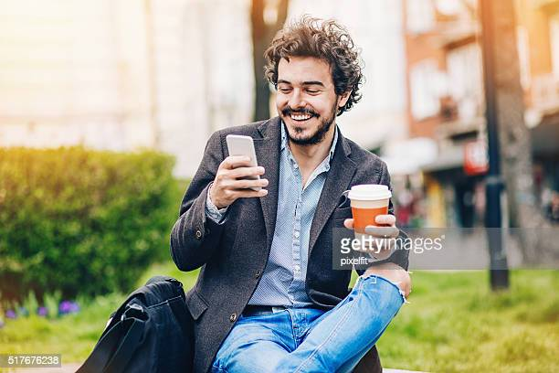 Smiling man reading a message