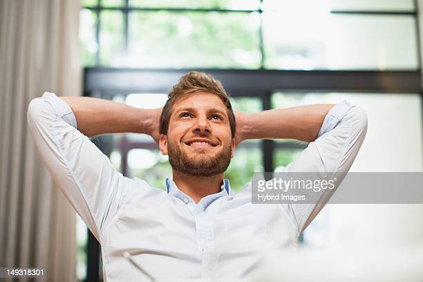 Smiling man relaxing in chair