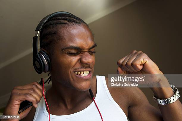 smiling man singing with headphones - clenching teeth stock pictures, royalty-free photos & images