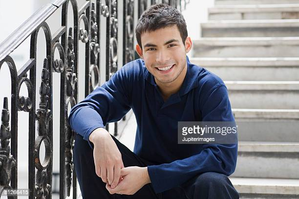 Smiling man sitting on stairs
