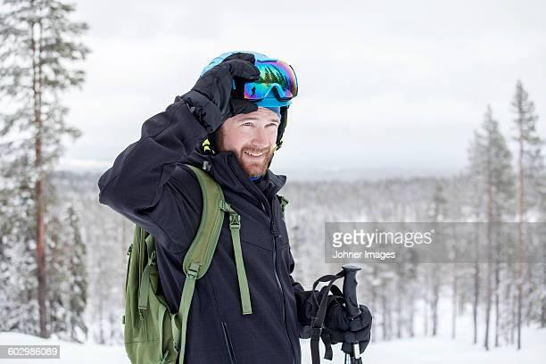 Smiling man skiing