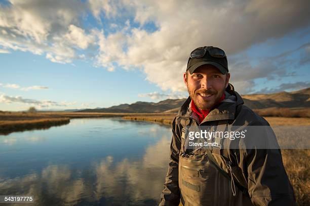 Smiling man standing near river
