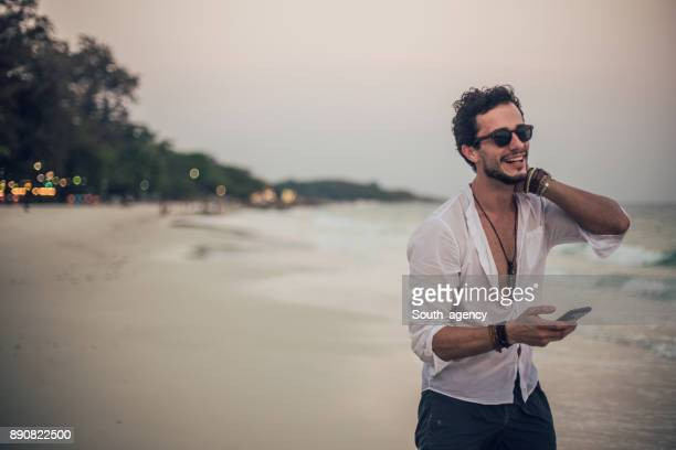 Smiling man standing on the beach