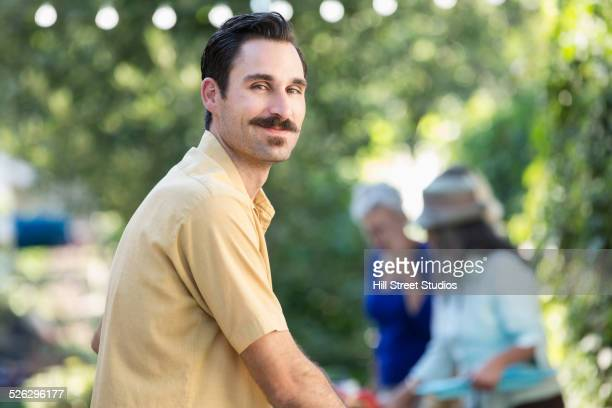 smiling man standing outdoors - mustache stock pictures, royalty-free photos & images