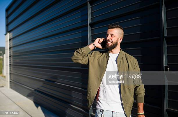 Smiling man telephoning with cell phone