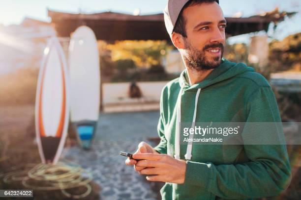 Smiling man using smartphone