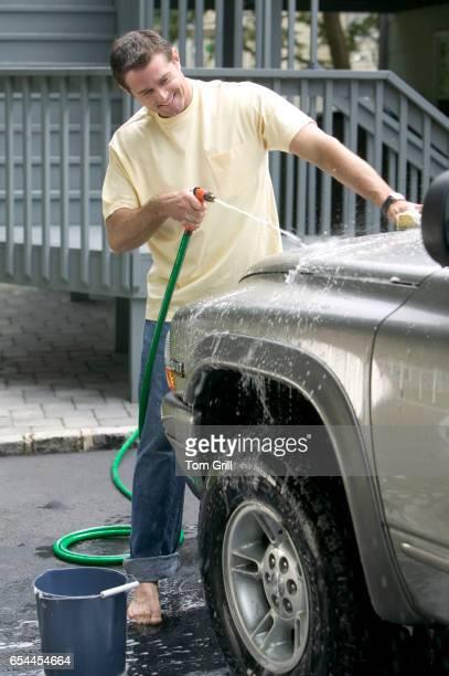 Smiling Man Washing Truck