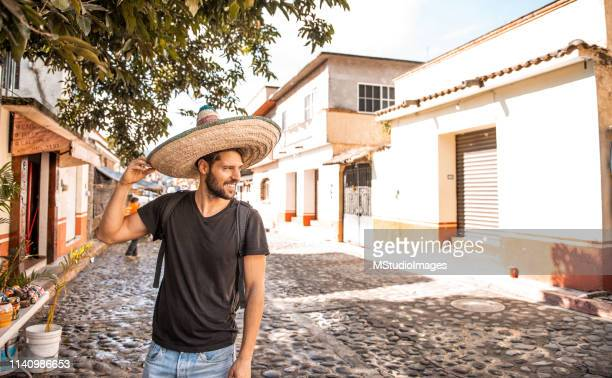 smiling man wearing sombrero. - cancun stock pictures, royalty-free photos & images