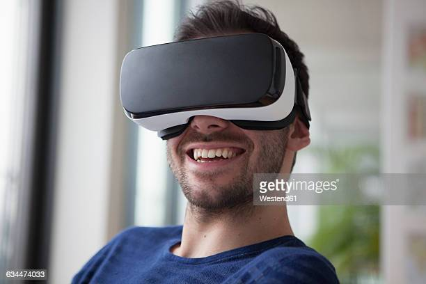 Smiling man wearing Virtual Reality Glasses