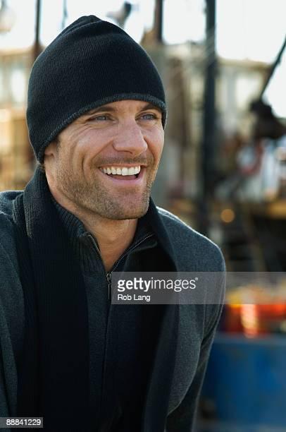 Smiling man wearing winter attire