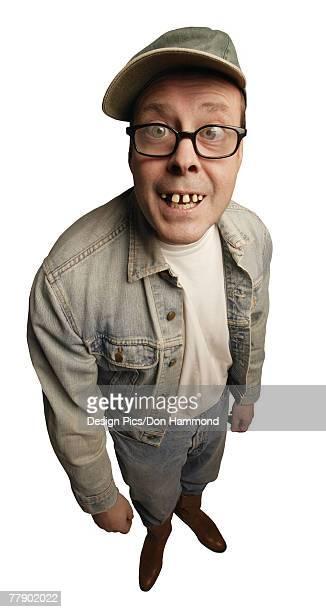 smiling man with buck teeth - buck teeth - fotografias e filmes do acervo