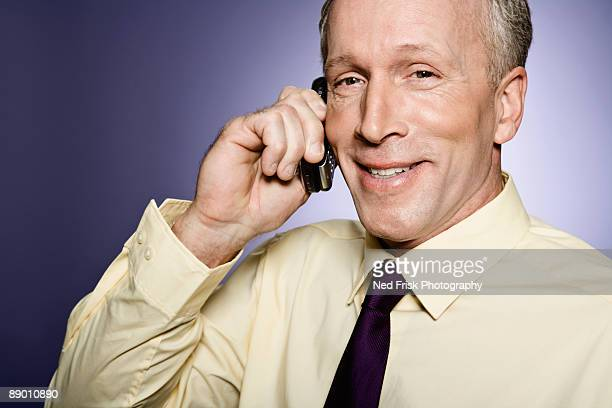 Smiling man with cell phone