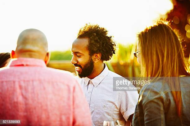 Smiling man with friends during neighborhood party