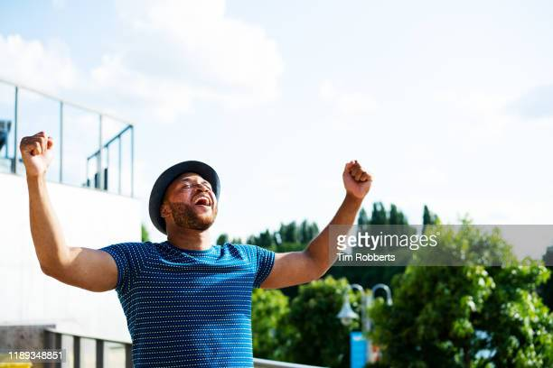 smiling man with good news - chanting stock pictures, royalty-free photos & images