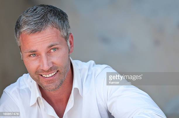 smiling man with grey hair