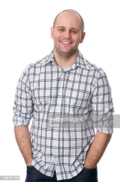 smiling man with hands in pockets