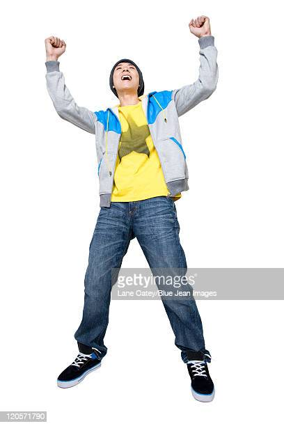 Smiling man with hands up in the air