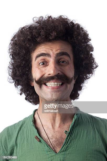 Smiling man with real big mustaches and long curly hair