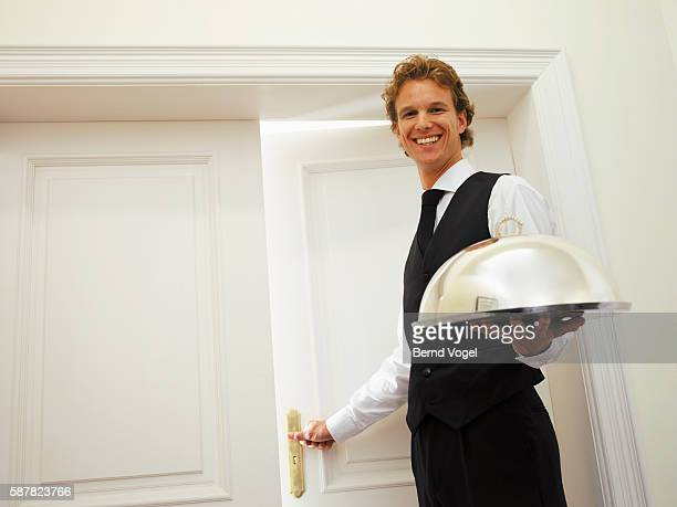 Smiling man with room service