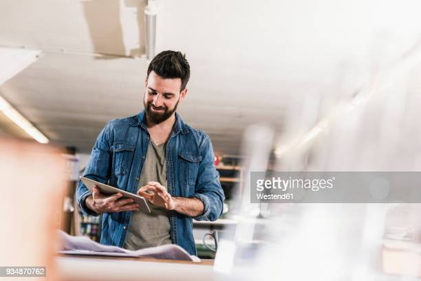 smiling man with tablet and draft in workshop - premium access stock pictures, royalty-free photos & images