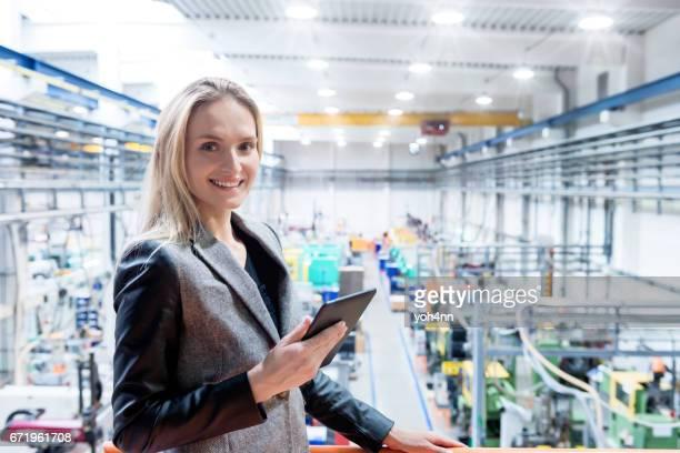 Smiling manager & digital tablet & factory