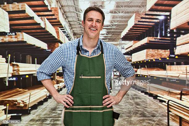 Smiling manager standing in warehouse