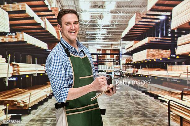 Smiling manager working in warehouse