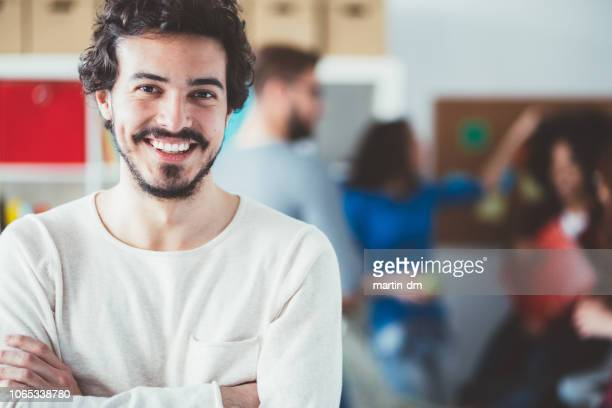 smiling man's portrait in the office - academy stock pictures, royalty-free photos & images
