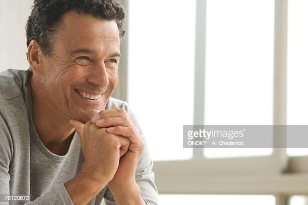 Smiling man's portrait, indoors