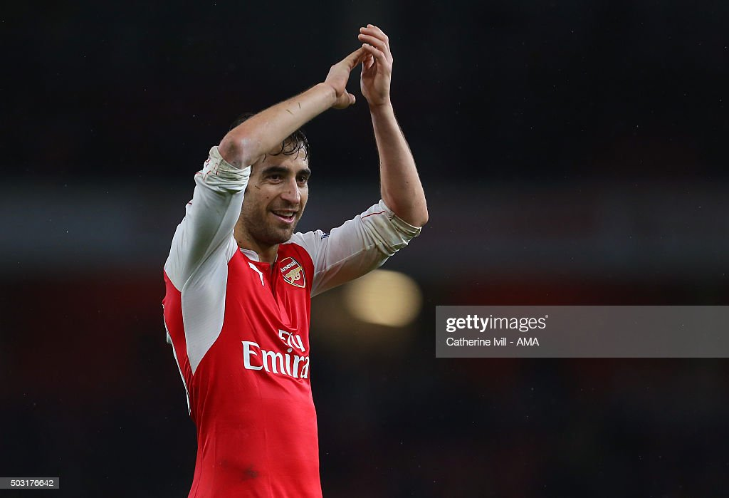 A smiling Mathieu Flamini of Arsenal applauds the Barclays Premier League match between Arsenal and Newcastle United at Emirates Stadium on January 2, 2016 in London, England.