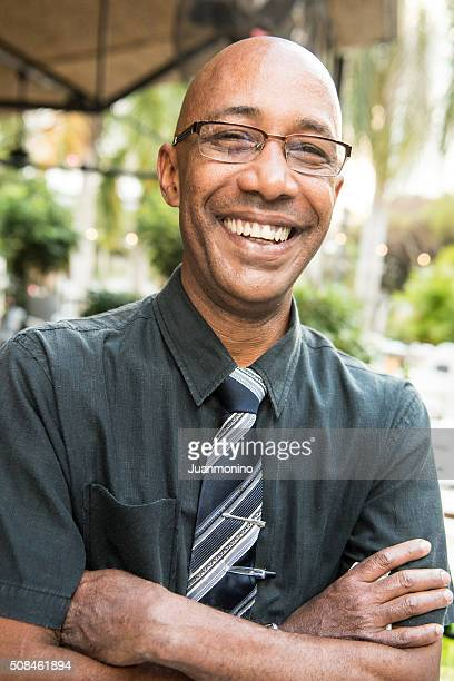 Smiling mature afro caribbean man