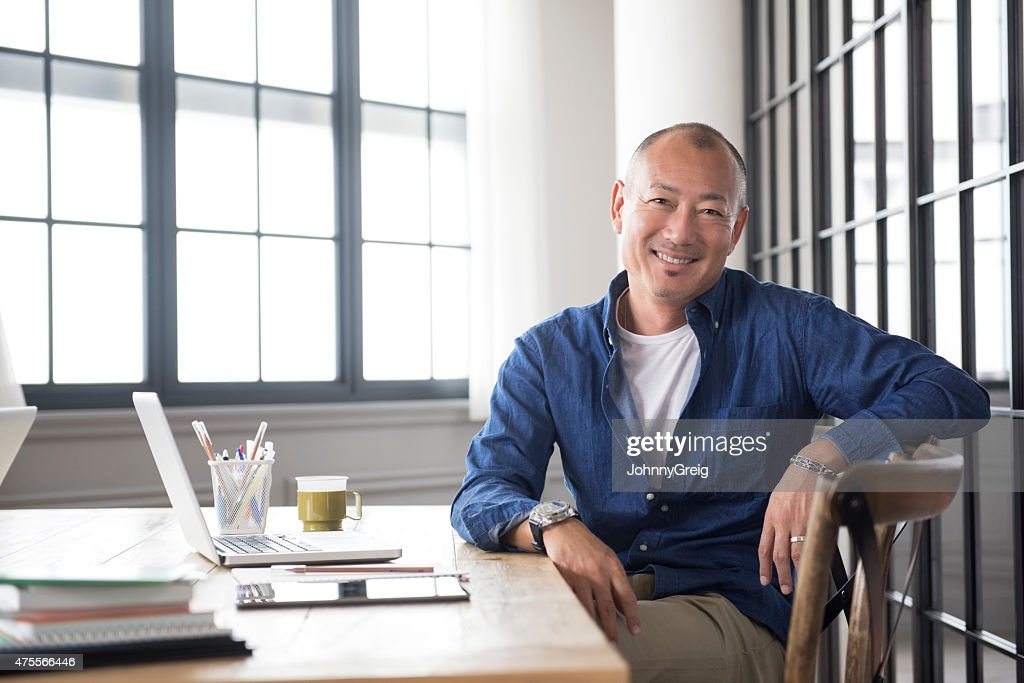 Smiling mature Asian man portrait : Stock Photo