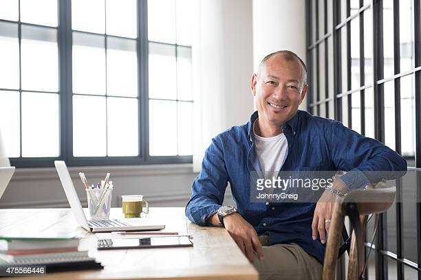 smiling mature asian man portrait - males stock pictures, royalty-free photos & images