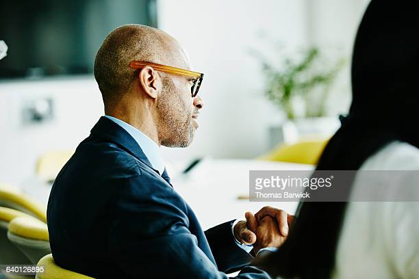 Smiling mature business executive in meeting
